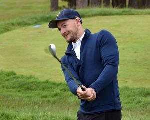 Otago player Brandon Hodgson practises his chip shots at the Otago Golf Club last week. PHOTO:...