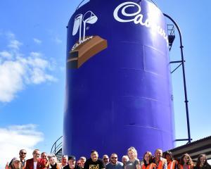 Those on the last tour through the former Cadbury factory stand next to the Cadbury silo. PHOTO:...