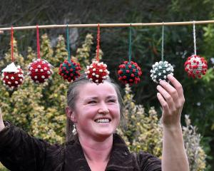 Dunedin artist Emma Hogg has crocheted ''Covid balls'' made out of wool and cotton. PHOTO: PETER...
