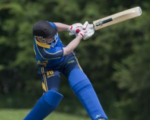 University-Grange batsman Sam Darling swings at a short-pitched delivery during a premier grade...