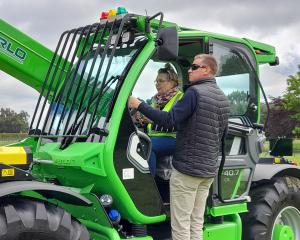 Anama arable farmer Sonya Spencer receives telehandler instruction from Power Farming owner Simon...