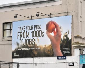 A billboard in Great King St, Dunedin, advertising the Work the Seasons scheme which was first...