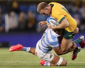 Wallaby Reece Hodge is tackled by Argentina's Pablo Matera at Newcastle's McDonald Jones Stadium....