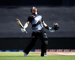 Glenn Phillips celebrates his record breaking ton against the West Indies at Mount Maunganui....