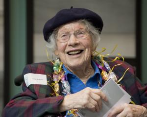 Honor McKellar enjoys a lighter moment at a reception yesterday to celebrate her 100th birthday...