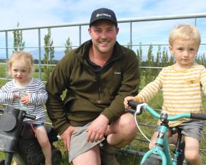 Mossburn dairy farmer and AG Proud founder Jason Checketts with his children Adelaide (2) and...
