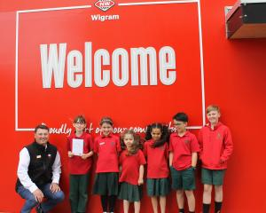 New World Wigram owner James Backhouse is presented with a thank you card by Oaklands School...