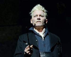 Johnny Depp dressed in character at the 'Fantastic Beasts: The Crimes of Grindelwald' theatrical...