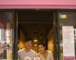 Nikko Kim and Joo Kim at their Jooni's Crepes window in George St yesterday. PHOTO: GREGOR...