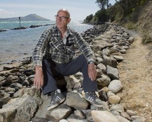 Karitane Coast Community Board member Andy Barratt sits on the damaged Huriawa Peninsula Walkway,...