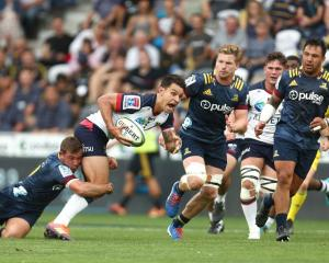 Rebels first five-eighth Matt Toomua is tackled during the side's match against the Highlanders...
