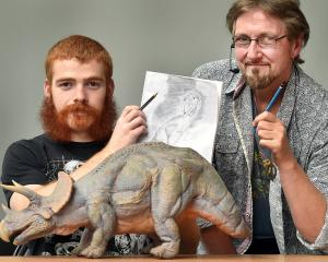 University of Otago geology and paleontology student Shane Meekin (left) gets advice on how to...