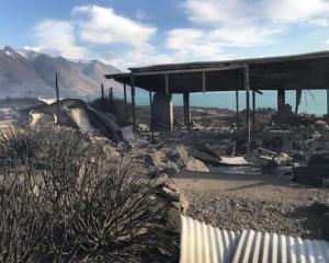 A fire-ravaged remains of a house near the shore of Lake Ohau. Photo: Supplied