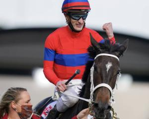 Jockey Mark Zahra celebrates aboard Verry Elleegant after winning the Caulfield Cup. Photo: Getty...