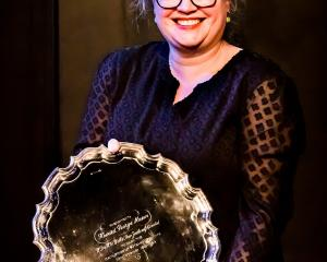 Dunedin playwright Emily Duncan receives the Bruce Mason Playwriting Award at the Playmarket...