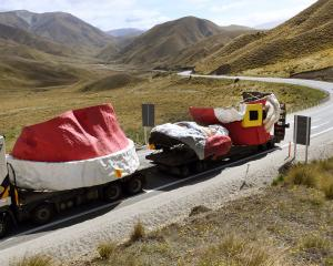 The truck convoy carrying the Auckland Farmers Santa passes the summit of the Lindis Pass on the...