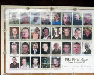 A photo of the miners' portraits at the Pike River memorial gardens at Atarau. PHOTO: HELEN MURDOCH