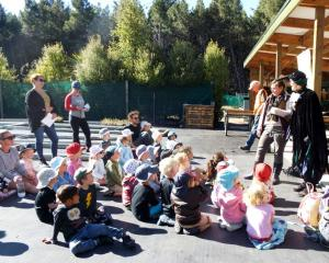 Wakatipu Reforestation Trust members educate preschoolers, in Queenstown, on biodiversity and...