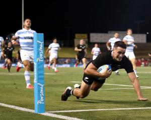 Will Jordan of the All Blacks makes a break to score a try during the 2020 Tri-Nations match with...