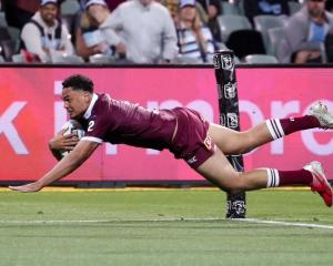 Xavier Coates scores for Queensland in last night's State of Origin game. Photo: Getty Images