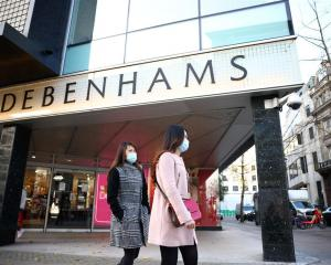 People walk past a Debenhams store on Oxford St in London. Photo: Reuters