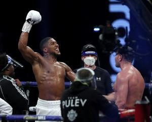Anthony Joshua celebrates winning his fight against Kubrat Pulev in London on Saturday. Photo:...