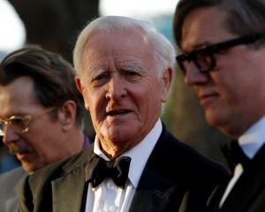 British author John Le Carre poses for photographers with British actor Gary Oldman and Swedish...