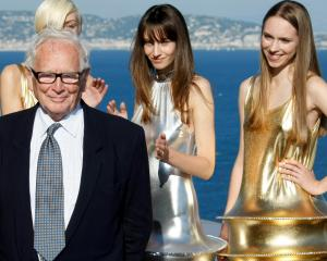 Pierre Cardin poses with models at the end of his 2009 spring/summer and autumn/winter ready-to...