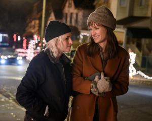 Kristen Stewart (left) and Mackenzie Davis star in the recently released movie Happiest Season....