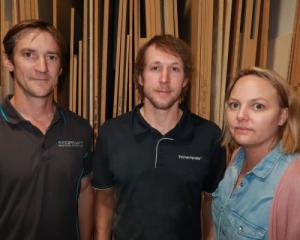 Clint Williams, centre, with employers Reuben Bogue and Angela Spackman. Photo: Mountain Scene