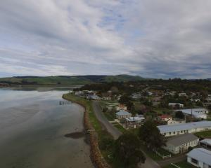 Pounawea, which means ''the meeting of the waters'', sits on the edge of the Catlins Lake, where...