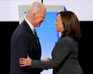 Former Vice President Biden and Senator Harris shake hands before the start of the second night...