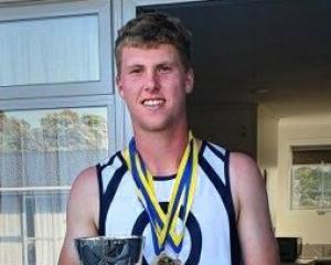 Cameron Moffitt with his national secondary schools championship medal haul. PHOTO: OTAGO BOYS'...