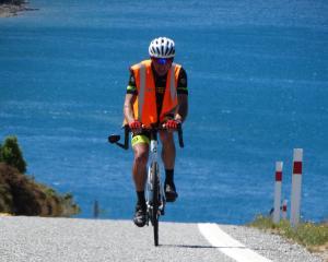 Steve Moffatt (70) heads for the summit on his bike. PHOTO: MARK PRICE