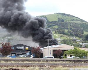 Smoke rises from the fire in Mosgiel this afternoon. Photo: Merv Chave