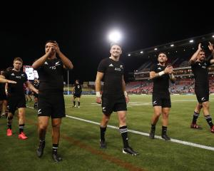 The All Blacks thank the crowd after the 38-0 win over Argentina at Newcastle on Saturday night....