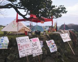 Protest banners at Ihumatao Photo: Nicole Hunt