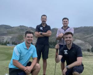 All smiles after playing 100 holes of golf on Wednesday at the Cromwell Golf Club are (from left)...