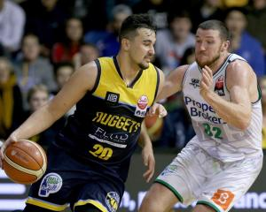 Kane Keil drives at Tom Vodanovich during this year's NBL Showdown final between the Otago...