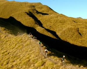 Members of the Queenstown Mountain Biking Club on the Rude Rock trail, which they completed in...