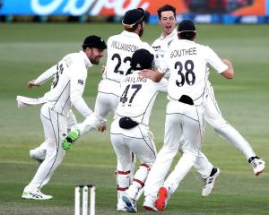 New Zealand celebrate the final wicket of Naseem Shah of Pakistan to win the match during day...