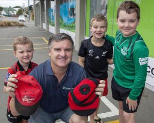 Former Canterbury wicketkeeper Paul Rugg with his two caps and three boys (from left) Spencer,...