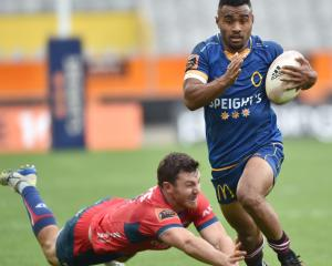 Otago winger Jona Nareki goes past Tasman first five-eighth Mitch Hunt at Forsyth Barr Stadium...