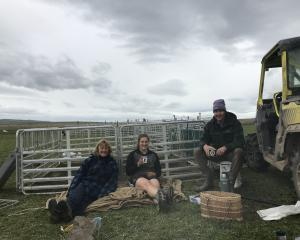 Tessa Jopp (centre) enjoys smoko break at tailing time with her parents Maree and Dave. PHOTO:...