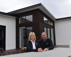 Fowler Homes Otago owners Nicky and Mel Fowler relax at a house their company built in Mosgiel —...