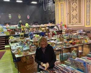 Regent Theatre volunteer Penny Smith and fellow volunteers prepare for the ''Good as New'' book...