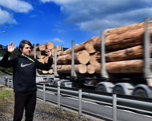 Robert Hoover (14) takes a photograph of a passing truck  on  State Highway 1 at Mosgiel...