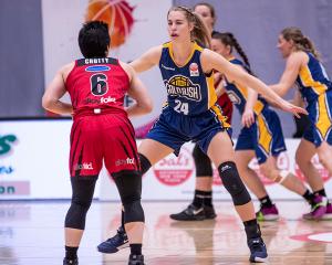 Otago Gold Rush forward Zoe Richards guards Canterbury's Shea Crotty during last night's NBL...