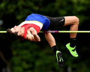 Hamish Kerr, of Christchurch, competes in the senior men's high jump during the Yvette Williams...