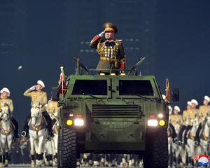 A view of a military parade to commemorate the 8th Congress of the Workers' Party in Pyongyang,...